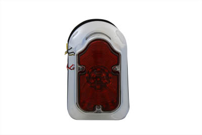 Chrome mod LED tombstone tail lamp assembly is larger than conventional size tombstone. Assembly includes a red LED bulb and a red lens.